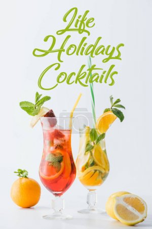 close up view of summer fresh cocktails with lemon and orange pieces, mint, life holidays cocktails lettering isolated on white