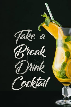 close up view of summer fresh cocktail with mint, lemon and orange pieces, take a break drink cocktail lettering isolated on black