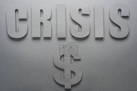 Photo for Top view of word crisis and dollar sign on grey background with shadows - Royalty Free Image