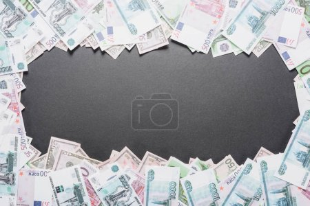 Photo for Top view of empty frame of dollar, euro and ruble banknotes on black background with copy space - Royalty Free Image