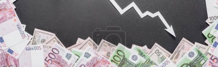 Photo for Panoramic shot of white recession arrow near dollar and euro banknotes on black background - Royalty Free Image