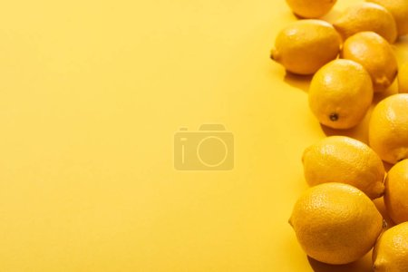 Photo for Fresh ripe whole lemons on yellow background with copy space - Royalty Free Image