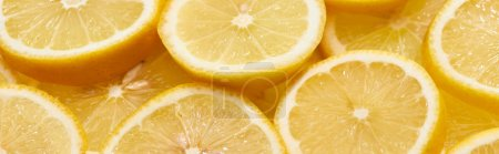 Photo pour Pile of ripe fresh yellow lemon slices, panoramic shot - image libre de droit