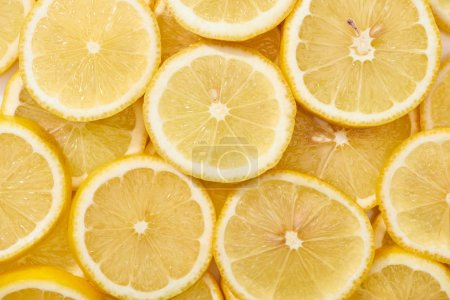 Photo for Top view of ripe fresh yellow lemon slices - Royalty Free Image