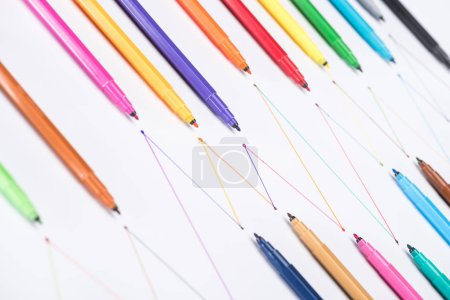 Photo for Colorful felt-tip pens on white background with connected drawn lines, connection and communication concept - Royalty Free Image