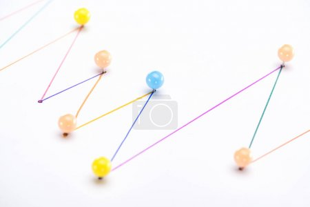 close up view of colorful connected drawn lines with pins, connection concept