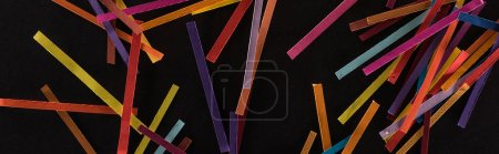 Photo pour Top view of multicolored abstract lines isolated on black background, connection and communication concept - image libre de droit