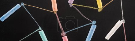 Photo for Top view of colorful chalk on black surface with connected drawn lines, connection and communication concept - Royalty Free Image