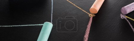 Photo for Panoramic shot of colorful chalk on black surface with connected drawn lines, connection and communication concept - Royalty Free Image