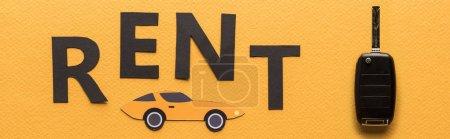 Photo pour Vue du dessus de la voiture coupée en papier, clé et lettrage noir sur fond orange, photo panoramique - image libre de droit