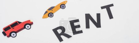 Photo for Top view of paper cut vehicles and black rent lettering on white background, panoramic shot - Royalty Free Image