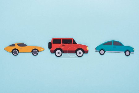 Photo for Top view of paper cut various cars on blue background - Royalty Free Image