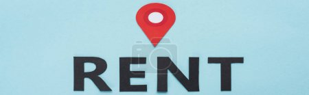 paper cut black rent lettering and red location mark on blue background, panoramic shot
