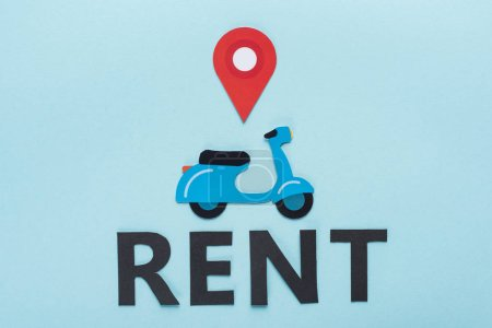 Photo for Top view of paper cut scooter with location mark near black rent lettering on blue background - Royalty Free Image