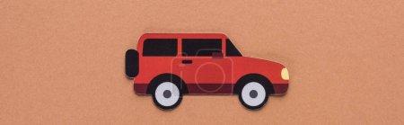Photo pour Vue du dessus de la voiture de papier coupé sur fond brun, concept de location de voiture - image libre de droit