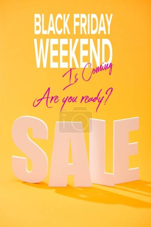 Photo for White sale lettering on bright orange background with black Friday weekend illustration - Royalty Free Image