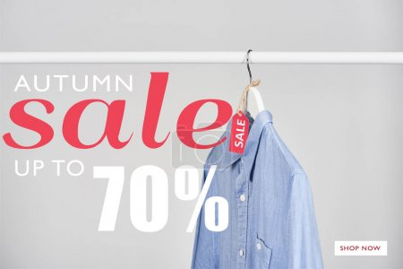 Photo for Blue shirt hanging with sale label isolated on white with autumn sale, up to 70 percent illustration - Royalty Free Image