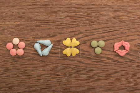 Photo for Top view of pet vitamins on wooden table - Royalty Free Image
