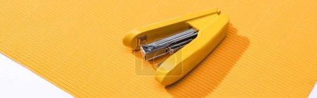 Foto de Foto panorámica de parabrisas amarillas sobre papel brillante aislado sobre blanco - Imagen libre de derechos