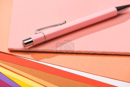 Photo for Selective focus of pen and notebook on bright and colorful papers - Royalty Free Image