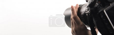 Photo for Cropped view of female photographer working with digital camera isolated on white, panoramic shot - Royalty Free Image