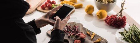 Photo for Cropped view of photographer making food composition for commercial photography on smartphone - Royalty Free Image