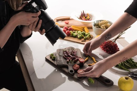 Photo for Cropped view of commercial photographers making photo shoot of food on digital camera - Royalty Free Image
