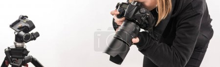 Photo for Cropped view of commercial photographer working with digital camera isolated on white - Royalty Free Image