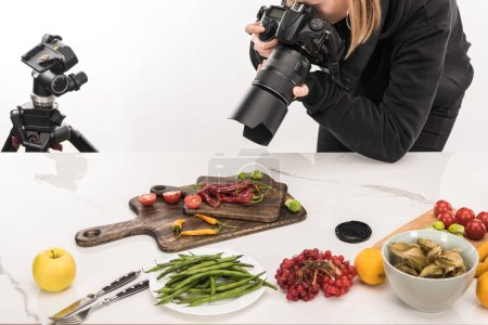 Photo for Female photographer making food composition for commercial photography and taking photo on digital camera - Royalty Free Image