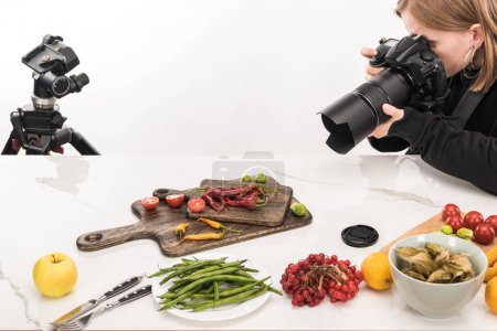Photo for Professional photographer making food composition for commercial photography and taking photo on digital camera - Royalty Free Image