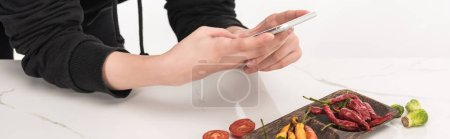 Photo for Cropped view of female photographer making food composition for commercial photography on smartphone - Royalty Free Image