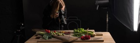 Photo for Professional photographer making food composition for commercial photography and taking photo on digital camera , panoramic shot - Royalty Free Image