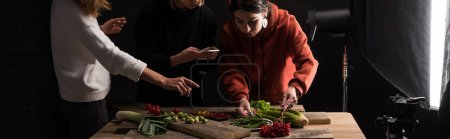 Photo for Cropped view of photographers making food composition for commercial photography on smartphone, panoramic shot - Royalty Free Image