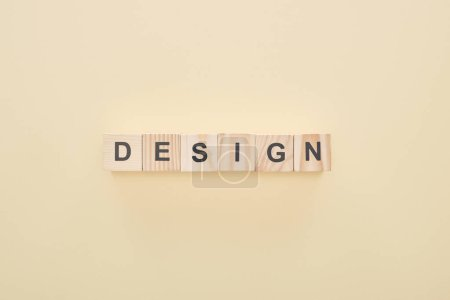 Photo for Top view of wooden blocks with design lettering on beige background - Royalty Free Image