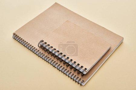Photo pour Deux cahiers vierges en papier sur fond beige - image libre de droit