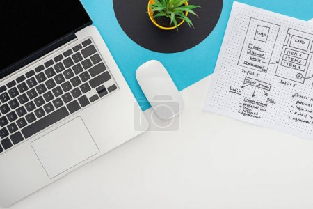 Photo for Top view of laptop, computer mouse, plant, website design template on abstract geometric background - Royalty Free Image