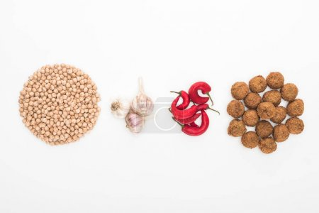 Photo for Top view of chickpea, garlic, chili pepper and falafel on white background - Royalty Free Image