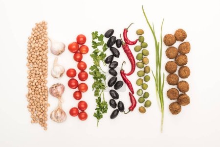 Photo for Top view of chickpea, garlic, cherry tomatoes, parsley, olives, chili pepper, green onion and falafel on white background - Royalty Free Image