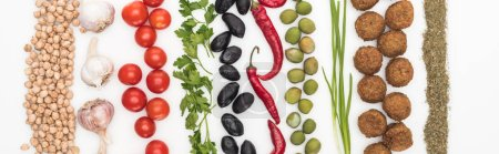 Photo for Top view of chickpea, garlic, cherry tomatoes, parsley, olives, chili pepper, green onion and falafel on white background, panoramic shot - Royalty Free Image