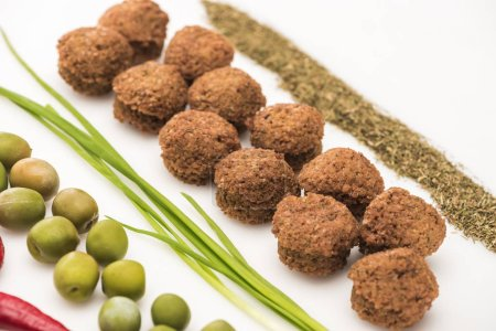Photo for Close up view of olives, green onion, herb and falafel on white background - Royalty Free Image