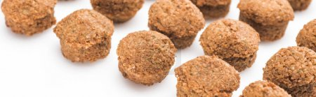 close up view of delicious fresh cooked falafel balls on white background, panoramic shot
