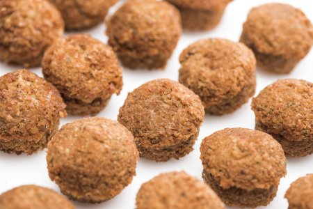 close up view of delicious fresh cooked falafel balls on white background