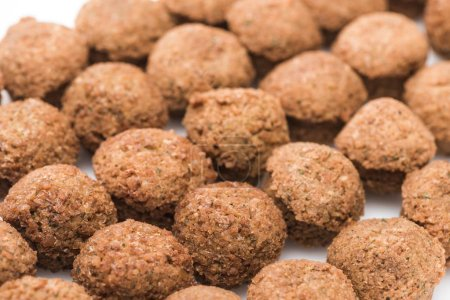 close up view of fresh cooked falafel balls on white background