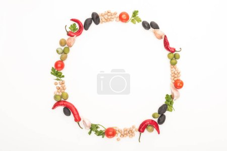 Photo for Top view of chickpea, garlic, cherry tomatoes, parsley, olives, chili pepper, green onion arranged in round frame isolated on white - Royalty Free Image