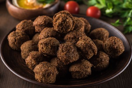 Photo for Close up view of fresh cooked falafel balls on wooden table - Royalty Free Image