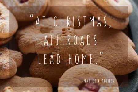 close up view of delicious baked snowflake cookie with at Christmas all roads lead home quote