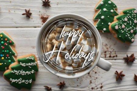 Photo pour Vue du dessus du cacao de Noël avec guimauve en tasse sur table en bois blanc près de l'anis et biscuits avec illustration joyeuse des fêtes - image libre de droit