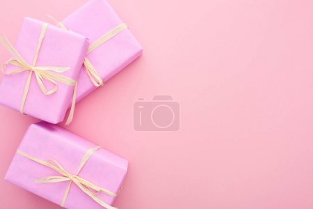 Photo for Top view of gift boxes with bows isolated on pink - Royalty Free Image