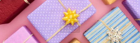 Photo for Panoramic shot of wrapped gift boxes on pink - Royalty Free Image