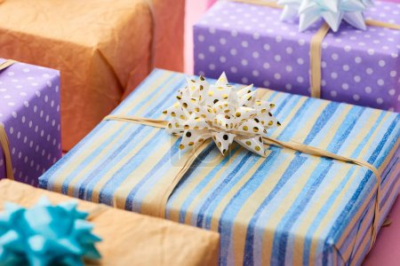 Photo pour Selective focus of stripped present near colorful gifts - image libre de droit